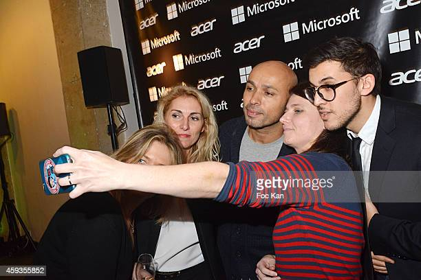 Eric judor and guests pose for a selfie during the Acer Pop Up Store Launch Party at Les Halles on November 20 2014 in Paris France