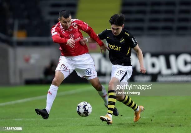 Eric Kahl of AIK tackles Emin Nouri of Kalmar during the Allsvenskan match between AIK and Kalmar FF at Friends arena on November 30, 2020 in Solna,...