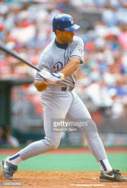Eric Karros of the Los Angeles Dodgers bats against the Philadelphia Phillies during a Major League Baseball game circa 1995 at Veterans Stadium in...