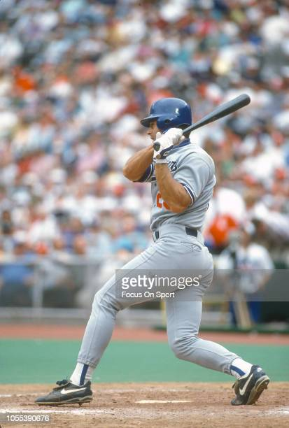 Eric Karros of the Los Angeles Dodgers bats against the Philadelphia Phillies during a Major League Baseball game circa 1994 at Veterans Stadium in...