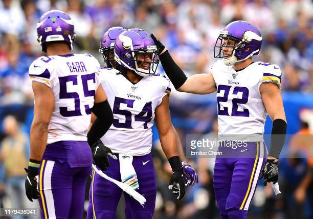 Eric Kendricks, Harrison Smith and Anthony Barr of the Minnesota Vikings react during the third quarter of their game against the New York Giants at...