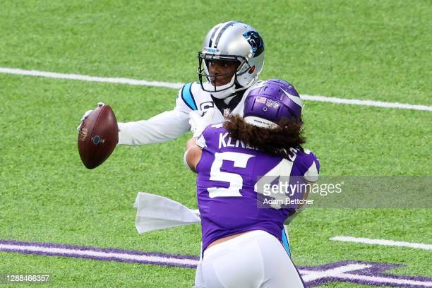 Eric Kendricks of the Minnesota Vikings attempts to sack Teddy Bridgewater of the Carolina Panthers during the first half at U.S. Bank Stadium on...