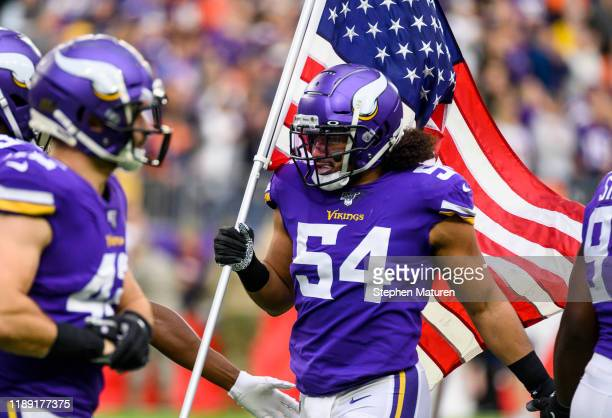 Eric Kendricks of the Minnesota Vikings carries an American flag during player introductions before the game against the Denver Broncos at U.S. Bank...