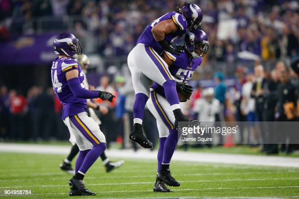 Eric Kendricks of the Minnesota Vikings celebrates with Anthony Barr after a interception against the New Orleans Saints during the first half of the...