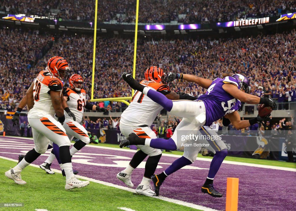 Eric Kendricks #54 of the Minnesota Vikings dives with the ball for a touchdown after intercepting Andy Dalton #14 of the Cincinnati Bengals in the first quarter of the game on December 17, 2017 at U.S. Bank Stadium in Minneapolis, Minnesota.