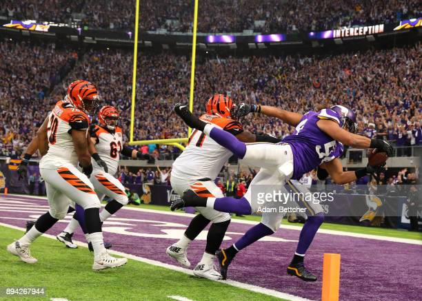 Eric Kendricks of the Minnesota Vikings dives with the ball for a touchdown after intercepting Andy Dalton of the Cincinnati Bengals in the first...