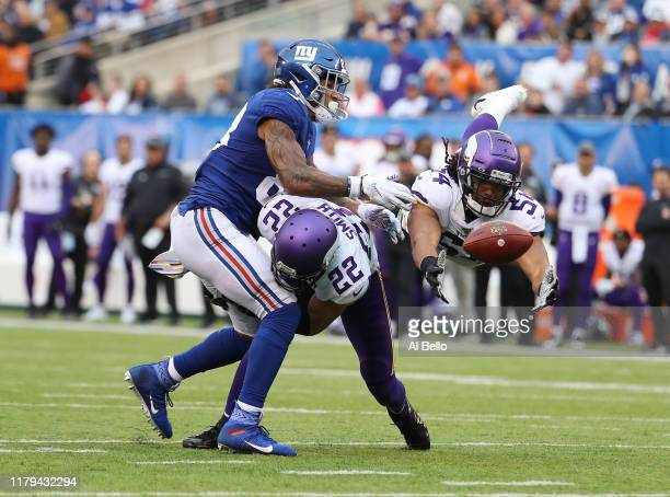 Eric Kendricks of the Minnesota Vikings misses an interception after Harrison Smith of the Minnesota Vikings breaks up a pass intended for Evan...