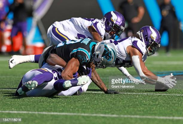 Eric Kendricks of the Minnesota Vikings recovers the fumbled ball from DJ Moore of the Carolina Panthers during the third quarter at Bank of America...