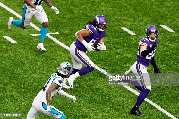 Eric Kendricks of the Minnesota Vikings runs after intercepting a pass during the second quarter against the Carolina Panthers at U.S. Bank Stadium...