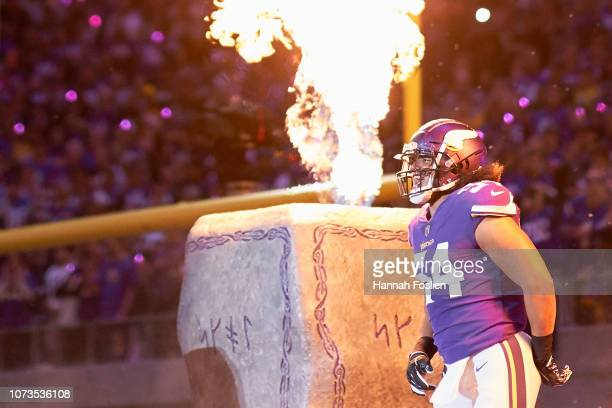Eric Kendricks of the Minnesota Vikings runs onto the field during player introductions before the game against the Green Bay Packers at U.S. Bank...