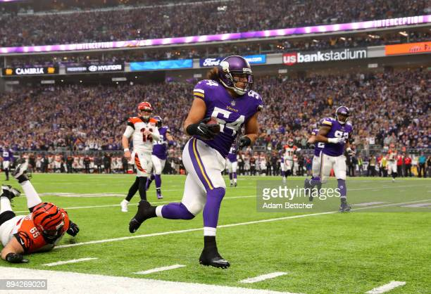 Eric Kendricks of the Minnesota Vikings runs with the ball after intercepting Andy Dalton of the Cincinnati Bengals in the first quarter of the game...