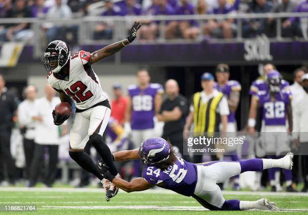 Eric Kendricks of the Minnesota Vikings tackles Mohamed Sanu of the Atlanta Falcons during the third quarter of the game at U.S. Bank Stadium on...
