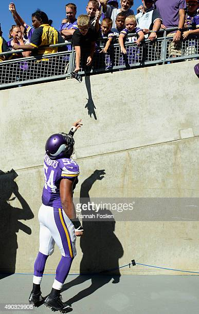 Eric Kendricks of the Minnesota Vikings tosses his gloves to a fan after the game against the San Diego Chargers of the game on September 27, 2015 at...