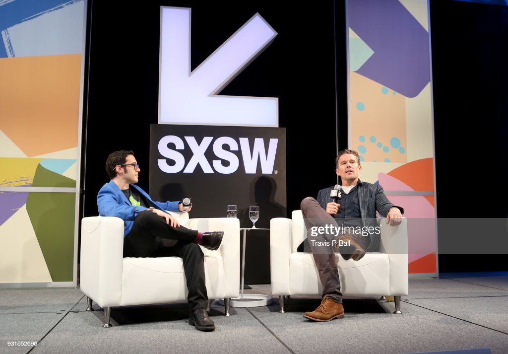 Eric Kohn (L) and Ethan Hawke speak onstage during SXSW at Austin Convention Center on March 13, 2018 in Austin, Texas.