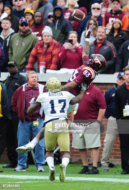 Eric Kumah of the Virginia Tech Hokies goes up for a pass against Lance Austin of the Georgia Tech Yellow Jackets on November 11 2017 at Bobby Dodd...
