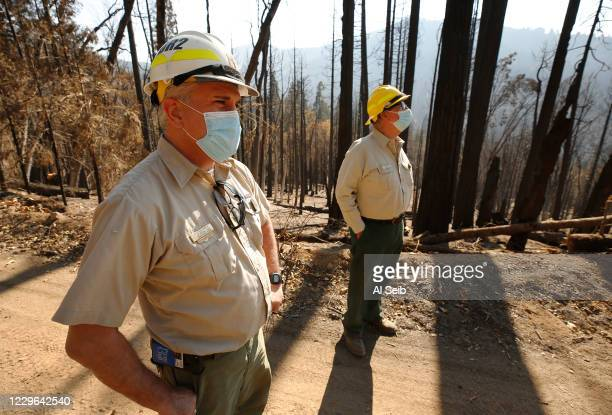 Eric La Price, left, Sequoia National Forest's Western Divide District ranger and George Powell, right, Sequoia National Forest ecosystem manager...