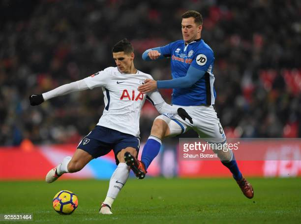 Eric Lamela of Tottenham Hotspur holds off Harrison McGahey of Rochdale during the Emirates FA Cup Fifth Round Replay match between Tottenham Hotspur...