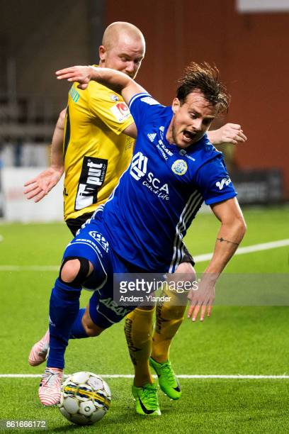 Eric Larsson of GIF Sundsvall is tackled by Simon Lundevall of IF Elfsborg during the Allsvenskan match between IF Elfsborg and GIF Sundsvall at...