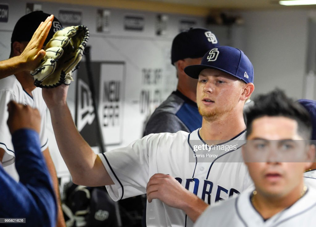 Eric Lauer #46 of the San Diego Padres is congratulated in the dugout after pitching in the seventh inning of a baseball game against the Los Angeles Dodgers at PETCO Park on July 10, 2018 in San Diego, California.