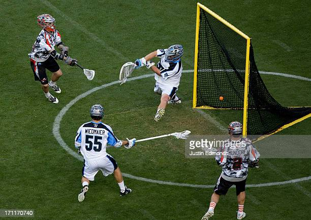 Eric Law of the Denver Outlaws scores past Brian Phipps of the Ohio Machine as Chad Wiedmaier and Brendan Mundorf look on during the second quarter...