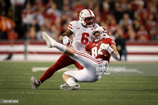 Eric Lee Jr #6 of the Nebraska Cornhuskers tackles Jake Ferguson of the Wisconsin Badgers in the first quarter at Camp Randall Stadium on October 6...