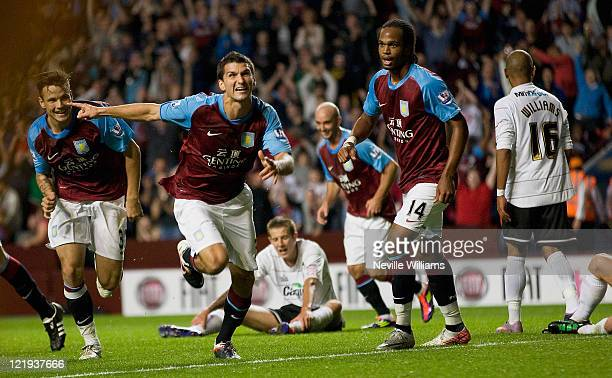 Eric Lichaj of Aston Villa celebrates after scoring the opening goal during the Carling Cup second round match between Aston Villa and Hereford...