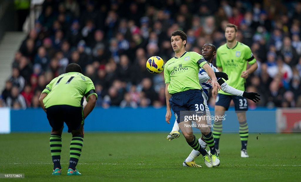 Eric Lichaj of Aston Villa challenges Shaun Wright Phillps of Queens Park Rangers during the Barclays Premier League match between Queens Park Rangers and Aston Villa at Loftus Road on December 01, 2012 in London, England.
