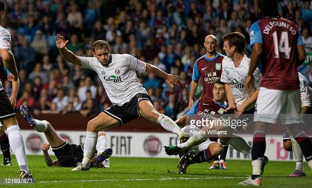 Eric Lichaj of Aston Villa scores the opening goal during the Carling Cup second round match between Aston Villa and Hereford United at Villa Park on...