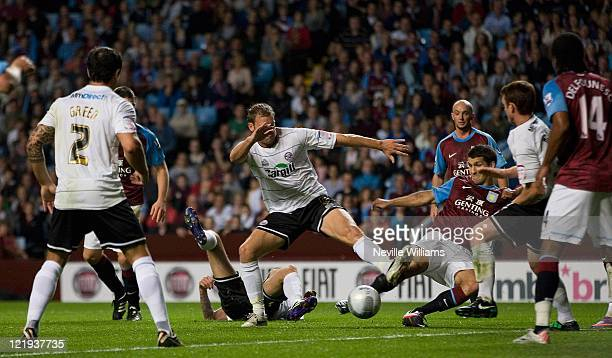 Eric Lichaj of Aston Villa scores the opening goal for Aston Villa during the Carling Cup round two match between Aston Villa and Hereford United at...