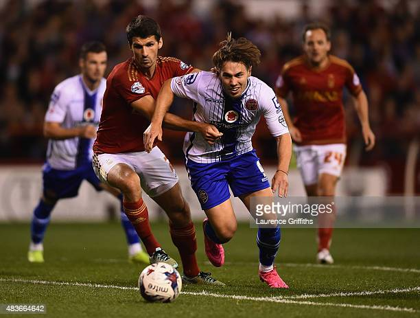 Eric Lichaj of Nottingam Forest battles with Tom Bradshaw of Walsall during the Capital One Cup First Round match between Nottingham Forest and...