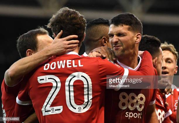 Eric Lichaj of Nottingham Forest celebrates scoring his side's first goal with team mates during The Emirates FA Cup Third Round match between...