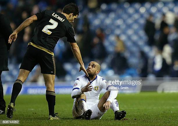 Eric Lichaj of Nottingham Forest FC extends to shake hands with Giuseppe Bellusci of Leeds United FC after Nottingham Forest defeated Leeds United 10...