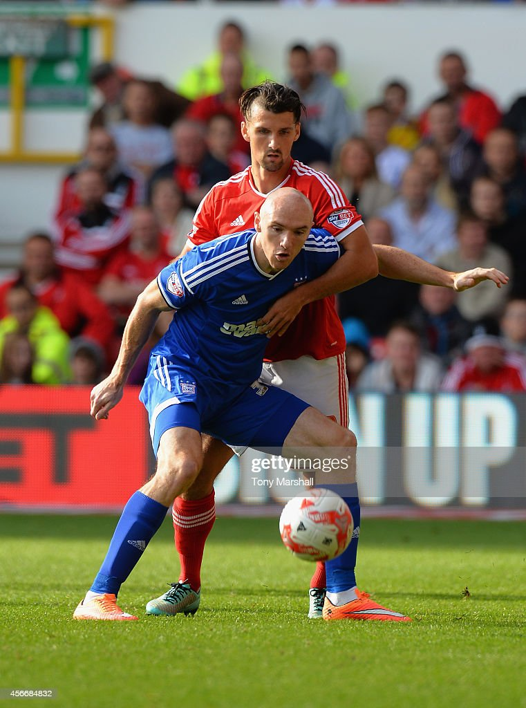Eric Lichaj of Nottingham Forest tackles Connor Sammon of Ipswich Town during the Sky Bet Championship match between Nottingham Forest and Ipswich Town at City Ground on October 5, 2014 in Nottingham, England.