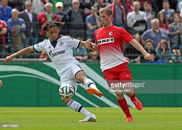 Eric Lickert of Freiburg battles for the ball with Leroy Sane of Schalke during the DFB Juniors Cup final match between SC Freiburg and FC Schalke 04...