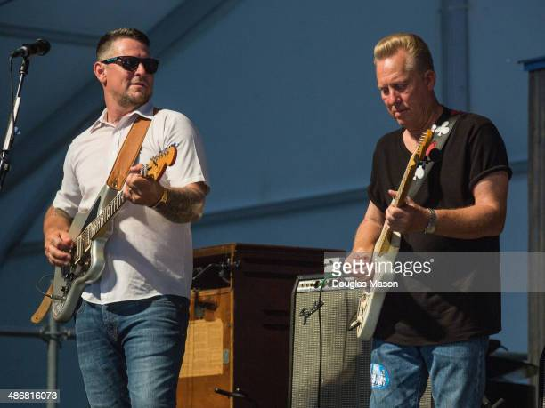 Eric Lindell and Anson Funderburgh of Eric Lindell and Co performs during the 2014 New Orleans Jazz Heritage Festival at Fair Grounds Race Course on...