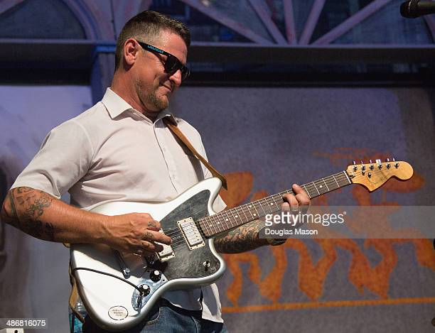 Eric Lindell and Co perform during the 2014 New Orleans Jazz Heritage Festival at Fair Grounds Race Course on April 25 2014 in New Orleans Louisiana