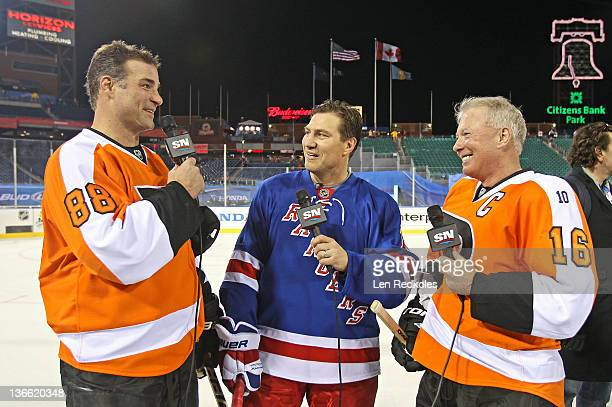 Eric Lindros and Bob Clarke of the Philadelphia Flyers take part in a TV interview after defeating the New York Rangers 31 following the Alumni Game...
