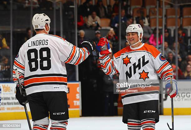 Eric Lindros and Dale Hawerchuk leave the ice following the 2016 Hockey Hall of Fame Legends Classic game at the Air Canada Centre on November 13...