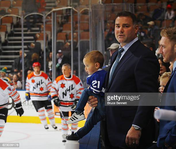 Eric Lindros and his son watch warmups prior to the 2016 Hockey Hall of Fame Legends Classic game at the Air Canada Centre on November 13 2016 in...