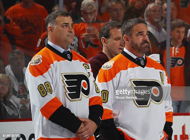 Eric Lindros and John Leclair take part in a pregame ceremony prior to the game between the Philadelphia Flyers and the Arizona Coyotes at the Wells...