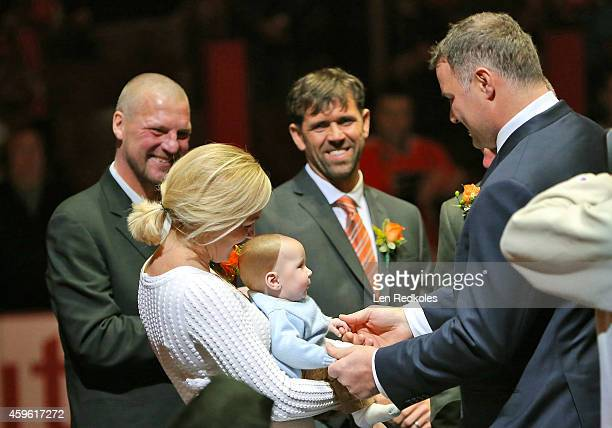 Eric Lindros greets his wife Kina and their new born son at the start of the Eric Lindros and John LeClair Flyers Hall of Fame Induction Ceremony...