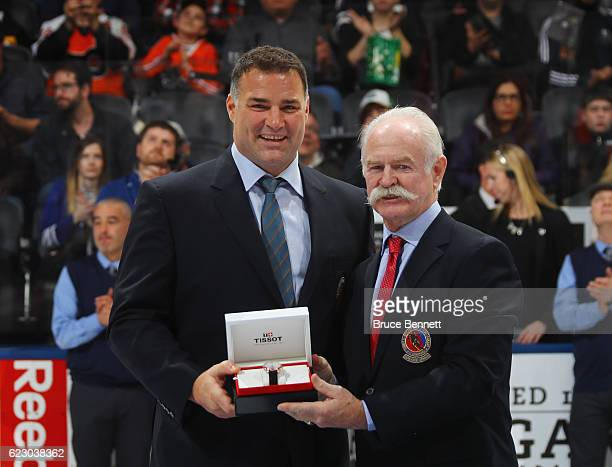 Eric Lindros is honored for his induction into the Hockey Hall of Fame and is joined by Lanny McDonald prior to the 2016 Hockey Hall of Fame Legends...