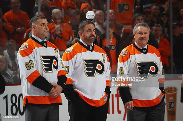 Eric Lindros John Leclair and Dave Schultz take part in a pregame ceremony prior to the game between the Philadelphia Flyers and the Arizona Coyotes...
