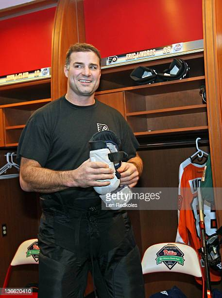 Eric Lindros of the Philadelphia Flyers puts on his equipment prior to his game against the New York Rangers during the Alumni Game prior to the 2012...