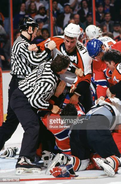 Eric Lindros of the Philadelphia Flyers tries to get at an unidentified player from the Montreal Canadiens circa 1996 at the CoreStates Center in...