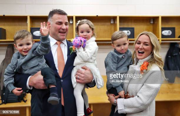 Eric Lindros with his Wife Kina Daughter Sophie Son's Carl and Ryan pose for a photo following his jersey retirement ceremony prior to a NHL game...