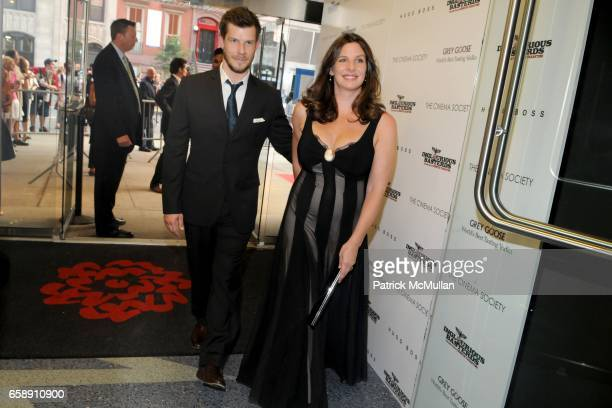 Eric Mabius and Ivy Sherman attend THE CINEMA SOCIETY HUGO BOSS host a screening of INGLOURIOUS BASTERDS at School of Visual Arts Theater on August...
