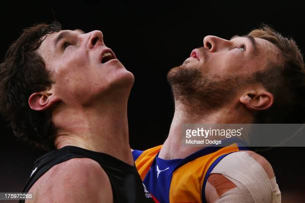 Eric Mackenzie of the Eagles contests for the ball against Jake Carlisle of the Bombers during the round 20 AFL match between the Essendon Bombers...