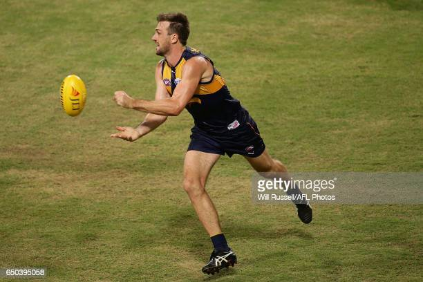 Eric Mackenzie of the Eagles handballs during the JLT Community Series AFL match between the West Coast Eagles and the Melbourne Demons at Domain...
