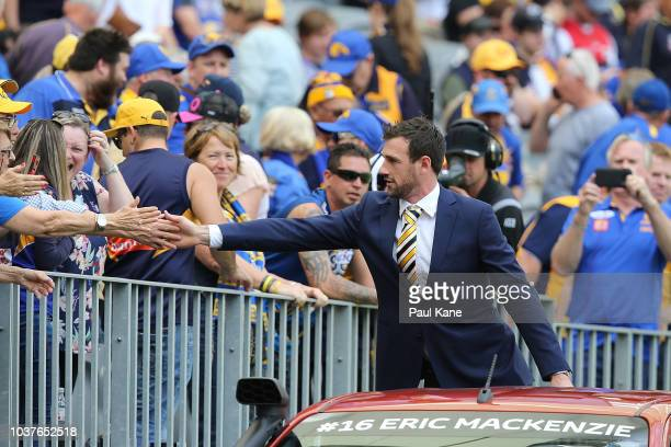 Eric Mackenzie of the Eagles is driven around the ground in a lap of honour after retiring from the game during the AFL Preliminary Final match...